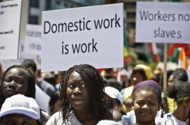 Migrant domestic workers, hold banners demanding basic labor rights as Lebanese workers, during a march at Beirut's seaside, Lebanon, Sunday, April 28, 2013. More than 200,000 workers mostly women from Asia and Africa work as maids in a country of 4 million people, many also come from places as far as Madagascar and Nepal, but the majority are from Sri Lanka, the Philippines, Ethiopia and Eritrea. (AP Photo/Hussein Malla)