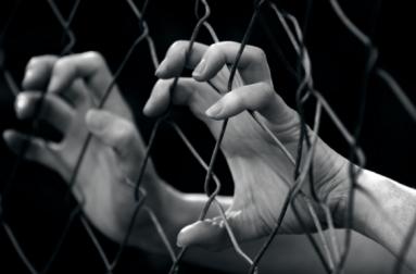 shutterstock-human-trafficking-hands-gate