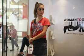 A woman with a price tag on her hand is displayed in the window of a store called Woman To Go in a shopping mall in Tel Aviv October 19, 2010, The store was opened for one day to raise awareness and protest against the trafficking of women. REUTERS/Nir Elias (ISRAEL - Tags: POLITICS SOCIETY) - RTXTLHD