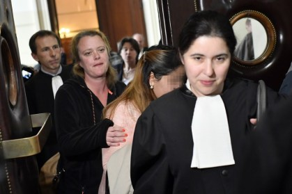 "One of the victims (2ndR) arrives to attend the so-called ""Conrad princesses"" trial in front of the Brussels criminal court for human trafficking, on May 11, 2017. United Arab Emirates' princess Sjeika Alnehayan and seven of her daughters are accused of mistreatment on 20 of their employees as they where living in one level of the Conrad hotel (now Steigenberger) in 2008. / AFP PHOTO / BELGA / DIRK WAEM / Belgium OUT"